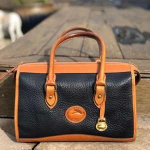 Dooney & Bourke dark blue and tan leather bag